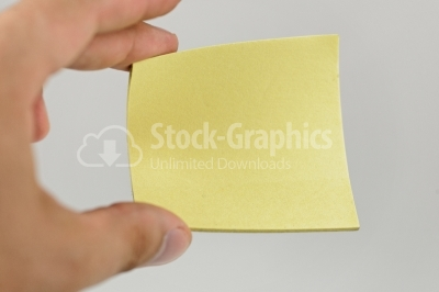 Man hand holding yellow paper, onwhite isolated background