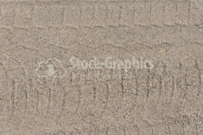 Wheels on wet sand texture