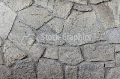 Stone wall surface with cracks