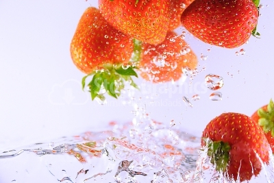 Bubbly fruit, strawberries - Stock Image