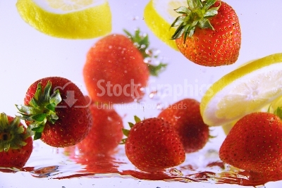 Bubbly Fruit, strawberries and lemon - Stock Image