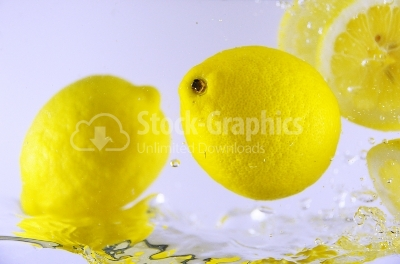 Bubbles in water and lemons - Stock Image