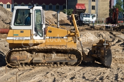 Heavy Equipment Backhoe and Dump Truck