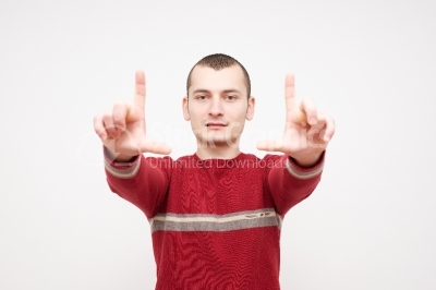 Male guy showing a loser sign