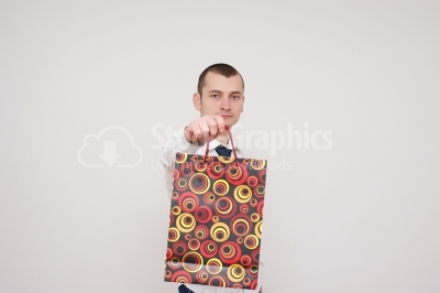 Gentleman holding some shopping bags