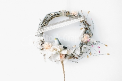 Wreath of flowers on the white wall
