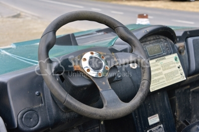 Steering wheel in rusty, old interior of ruined car
