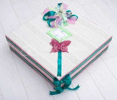 Christmas box with green scarf and purple buterfly