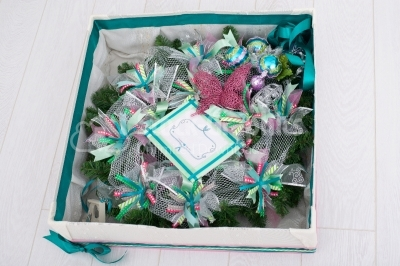 Gift box filled with christmas wreath