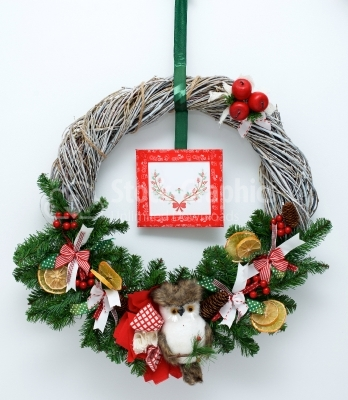 Christmas wreath with toys isolated on white background