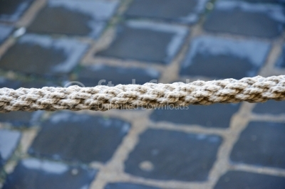Old rope with pavement background
