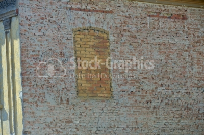 Window on wall filled in with bricks