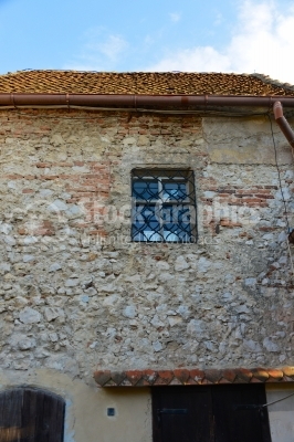 Old window on ancient building