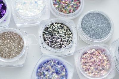 Collection of nail glitters of different colors, close up.