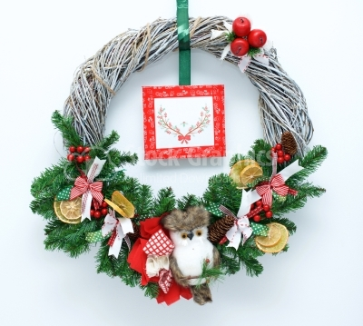 Christmas wreath with small litte owl as decoration