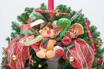 Reindeer mascot placed on christmas wreath