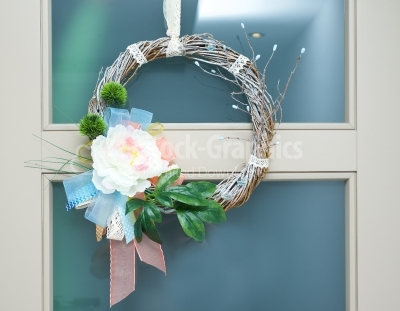 Spring wreath hanged on door