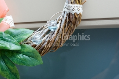 Glass balls filled with blue water on spring wreath