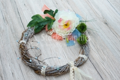 Rutsic wreath on wood background