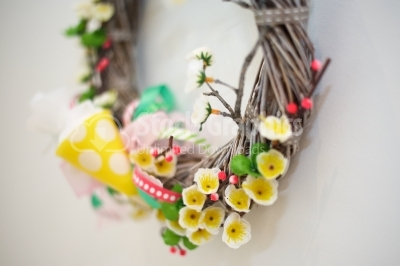 Spring wreath on white wall