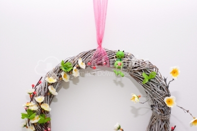 Wood wreath with pink scarf