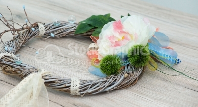 Artificial wreath on wood background