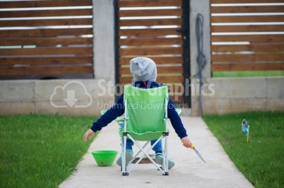 Kid sitting on a small bench