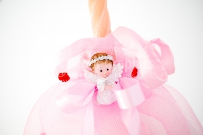 Christening candle with small angel figurine