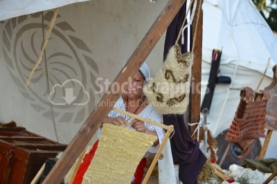 Aoman who weaves on a loom,