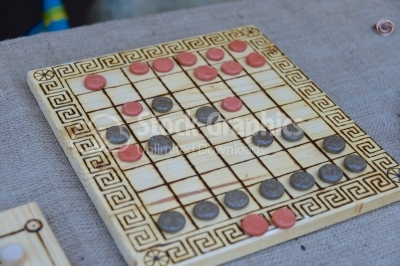 A Roman board game with red and black stones