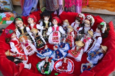 Traditional porcelain dolls for sale in a souvenir store in Bran