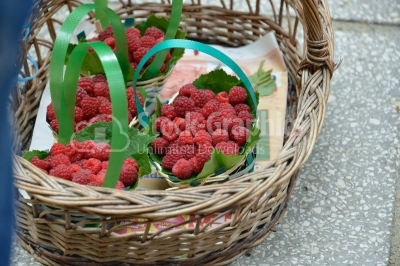 Fresh juicy organic strawberries in wicker basket