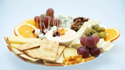 Cheese plates served with grapes, crackers and nuts