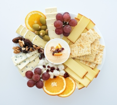 Cheese plate with grapes, bread, walnut