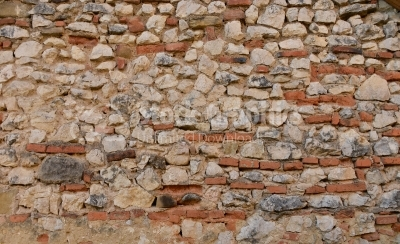 Stone wall built with many bricks in it