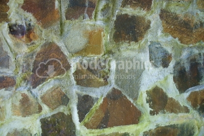 Detail of a wall made of colourful natural stone