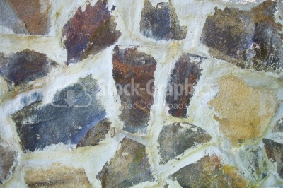Urban stone wall with abstract pattern as creative background