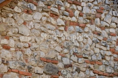 Stone wall built with bricks in it