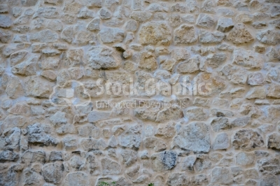 Rustic stone wall plastered on it
