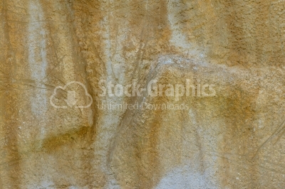 Yellow cement wall with plaster relief