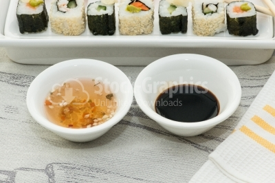 Two white bowls with japanesse souce