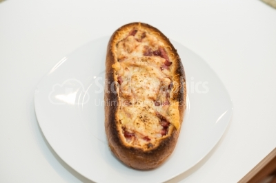 Hot snack with parmesan and bacon
