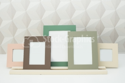 Blank picture frames on the table