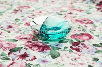 Perfume bottle on floral background