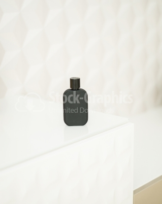 Dark vertical perfume bottle