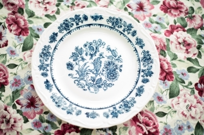 Simple vintage dinner plate over a floral background