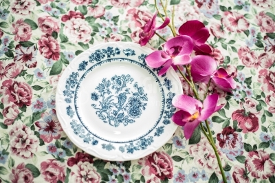 Vintage dinner plate on floral background