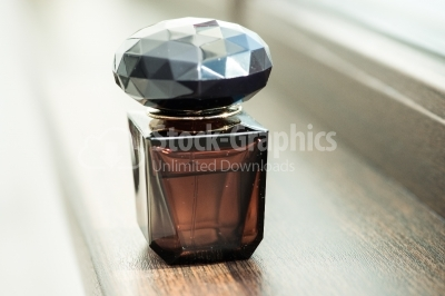 Perfume bottle near window