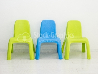Two chairs standing near wall