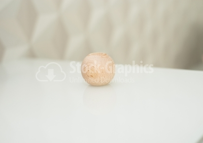 Wood ball on glass table